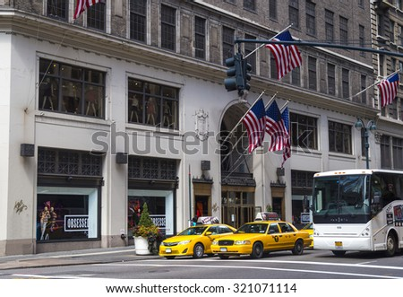 NEW YORK CITY - AUGUST 30, 2014: Traffic in New York City with famous yellow-coloured taxi cabs passing by - stock photo