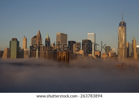 New York City - beautiful sunrise over manhattan with manhattan and brooklyn bridge