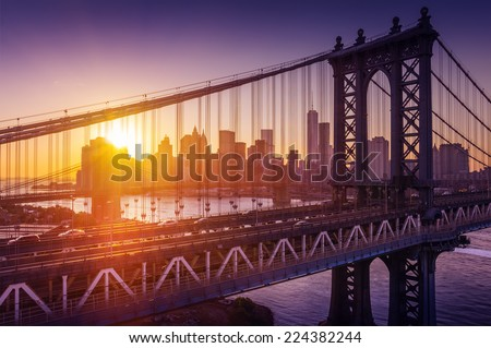 New York City - beautiful sunset over manhattan with manhattan and brooklyn bridge  - stock photo