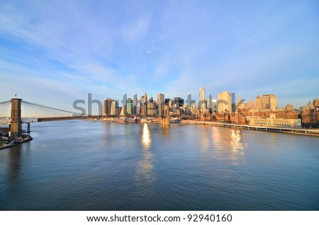 New York City, Brooklyn Bridge and lower Manhattan in a sunny morning, New York United States - stock photo