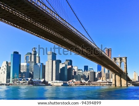 New York City Brooklyn Bridge and Manhattan skyline - stock photo