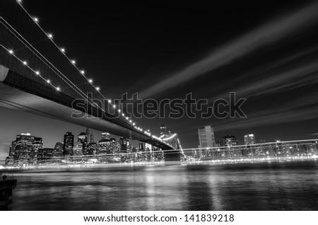 New York City, Brooklyn Bridge at night - New York, United States - Black and White toned  - stock photo