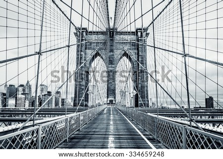 New York City Brooklyn Bridge in Manhattan closeup with skyscrapers and city skyline over Hudson River. Black and white. - stock photo