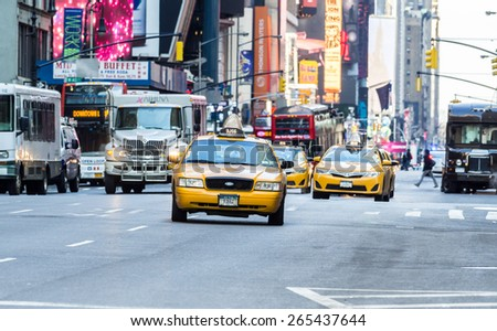 New York City circa dec 2014: Typical scenario of manhattan with a taxi hurtling down the road