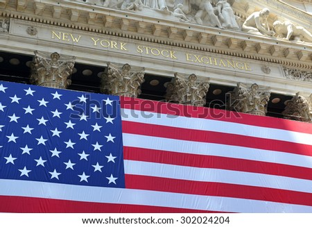 NEW YORK CITY - CIRCA JULY 2015. Known as a symbol of capitalism and prosperity, The New York Stock Exchange is also popular tourist attraction located in downtown Manhattan. - stock photo