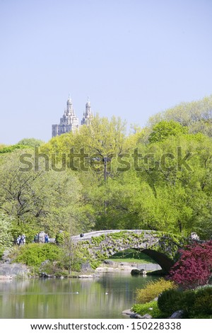 NEW YORK CITY - CIRCA 2006: Lake in Central Park in Spring with Dakota Apartments in background, New York City, New York - stock photo