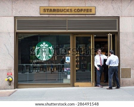 NEW YORK CITY - CIRCA MAY 2015: People in front of Starbucks store close to Grand Central Station. Starbucks is the largest coffeehouse company in the world. - stock photo