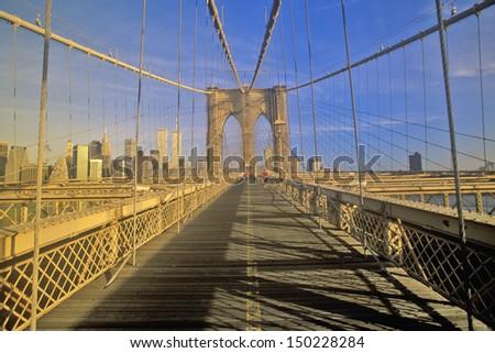 NEW YORK CITY - CIRCA 1990's: Walkway on Brooklyn Bridge on way to Manhattan, New York City, NY - stock photo