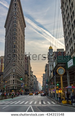 NEW YORK CITY - CIRCA 2016: The Flatiron Building stands between Broadway and Fifth Avenue in Manhattan, New York City. The Flatiron Building is a 22 story triangular shaped building built in 1902. - stock photo
