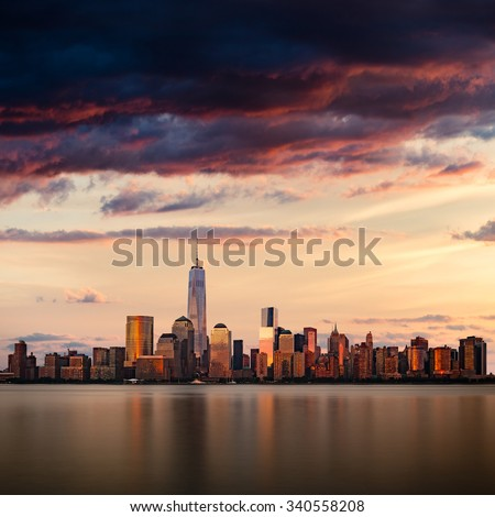 New York City cityscape during dramatic sunset - stock photo