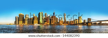 New York City cityscape with Brooklyn bridge on a sunny day - stock photo