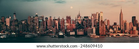 New York City day and night. This photo is blended with sunset and twilight shots. - stock photo