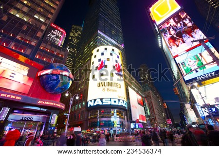 NEW YORK CITY - DEC 15: Crowds of people and lots of advertising at junction of Broadway and Times Square at evening on December 15, 2012 in New York, NY, USA.  - stock photo