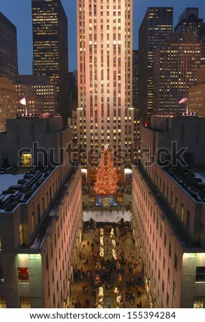 NEW YORK CITY - Dec, 2005: New York City landmark, Ice skaters and tourists on December, 2005, visit the famous Rockefeller Center Christmas tree during the holidays. - stock photo
