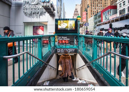 NEW YORK CITY - DEC. 12:  Penn Station subway entrance in midtown Manhattan on December 12, 2013.  Pennsylvania Station  is the major intercity train station and a major commuter rail hub in NYC. - stock photo
