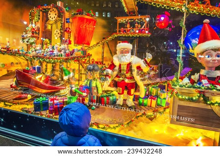 NEW YORK CITY - DECEMBER 20:  A little boy watching holiday window display at Macy's store on December 20, 2014 in Manhattan, New York City, USA.  - stock photo