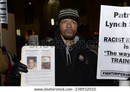 NEW YORK CITY - DECEMBER 19 2014: a planned demonstration in support of the NYPD in front of city hall prompted a larger counter-protest by activists opposing police brutality. Nicholas Heyward, Sr.