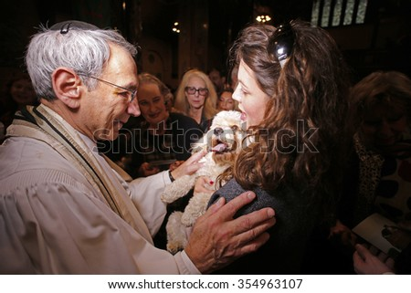 NEW YORK CITY - DECEMBER 13 2015: Cindy Adams & commissioner William Bratton hosted the seventh annual Blessing of the Animals at Christ Church in Manhattan. Rabbi Peter Rubinstein confers blessing