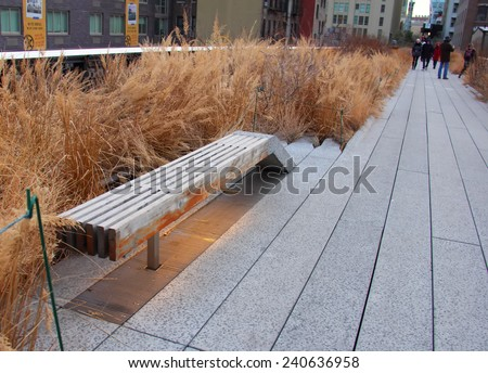 NEW YORK CITY - DECEMBER 25: High Line Park in NYC seen on December 25, 2013.The High Line is a public park built on an historic freight rail line elevated above the streets on Manhattans West Side. - stock photo