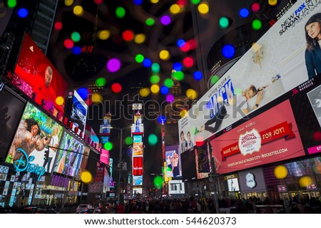 NEW YORK CITY - DECEMBER 23, 2016: Holiday lights decorate the sky as Times Square prepares for New Year's Eve.