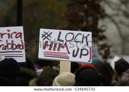"NEW YORK CITY - DECEMBER 12 2016: Hundreds of activists gathered in front of Trump International in Columbus Circle for a ""Not My President!"" rally & march against the inauguration of Donald Trump."