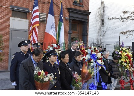 NEW YORK CITY - DECEMBER 20 2015: mayor de Blasio joined the families of slain officers Wenjian Liu and Rafael Ramos to dedicate a plaque at the 84th precinct. Wreath laying ceremony