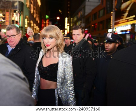 NEW YORK CITY - DECEMBER 31 2014: more than one million celebrants marked the new year in Times Square. Singer Taylor Swift arrives to perform just before midnight. - stock photo