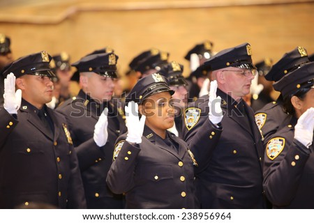 NEW YORK CITY - DECEMBER 19 2014: several dozen NYPD officers were promoted in a ceremony held at One Police Plaza, presided over by Mayor Bill De Blasio & NYPD Commissioner William Bratton - stock photo