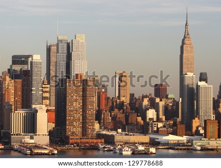 NEW YORK CITY - DECEMBER 24: Sunset view of Manhattan New York City on December 24, 2010.Manhattan is the most densely populated and the oldest of the five boroughs of New York City. - stock photo