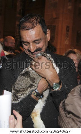 NEW YORK CITY - DECEMBER 7 2014: the ASPCA & NY Post hosted its sixth annual blessing of the animals at Christ Church on Manhattan's Upper West Side. Hasan Rouhani with rescue bunny, Patrick