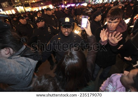 NEW YORK CITY - DECEMBER 3 2014:thousands of activists filled the streets of Manhattan after it was announced that the grand jury failed to indict NYPD officer Joe Pantaleo in the death of Eric Garner - stock photo
