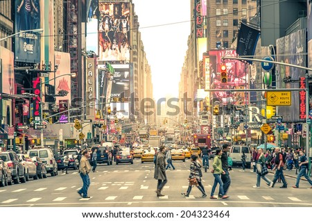 NEW YORK CITY -DECEMBER 22,2013: Times Square, featured with Broadway Theaters and animated LED signs, is a symbol of New York City and the United States - stock photo