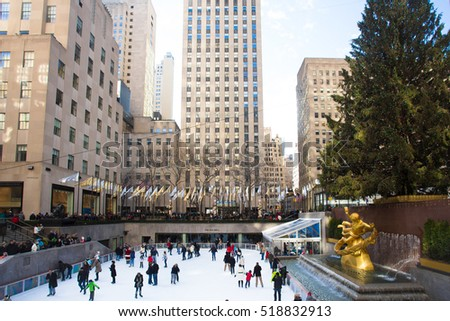 NEW YORK CITY - DECEMBER 13, 2013:  View from Rockefeller Center in Manhattan during the Christmas holiday season with skaters and Christmas tree.