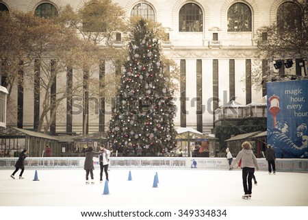 NEW YORK CITY - DECEMBER 4, 2015:  Vintage style View of Citi Pond ice skating rink at Bryant Park in Manhattan with Christmas Tree on display  - stock photo