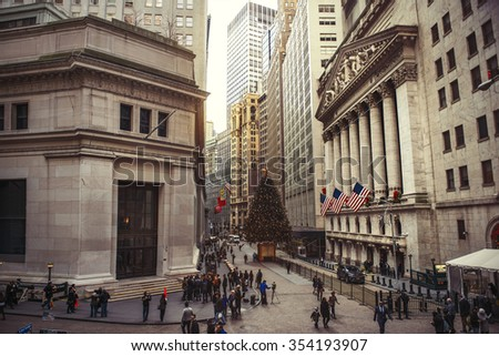 NEW YORK CITY - DECEMBER 15: Wall Street with New York Stock Exchange in Manhattan Finance district during Christmas, December 15, 2015 in Manhattan, New York City.