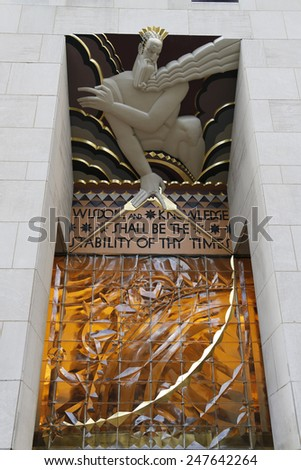 NEW YORK CITY - DECEMBER 18, 2014: Wisdom, an art deco frieze by Lee Lawrie over the entrance of GE Building at Rockefeller plaza  - stock photo