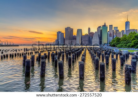 New York City downtown skyline in beautiful sunset.