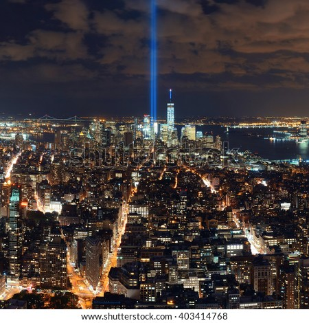 New York City downtown skyline night view and 911 tribute light. - stock photo