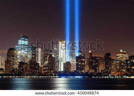 New York City downtown urban architecture at night and September 11 tribute light - stock photo