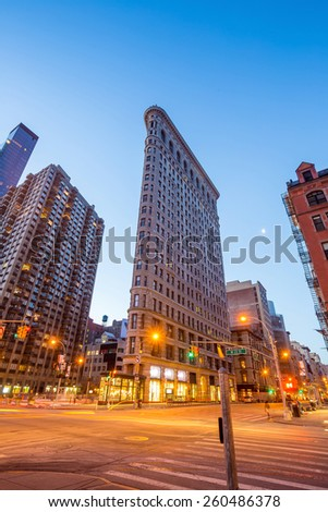 NEW YORK CITY - FEB 11: Flat Iron building, considered to be one of the first skyscrapers ever built, with New York City street view. February 11, 2015 in Manhattan, New York City. - stock photo