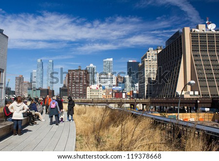 NEW YORK CITY - FEB 20: High Line Park in NYC as seen on February 20, 2012. In 2009 this former elevated freight railroad spur on NYC's west side opened as an aerial green way and continues to expand - stock photo