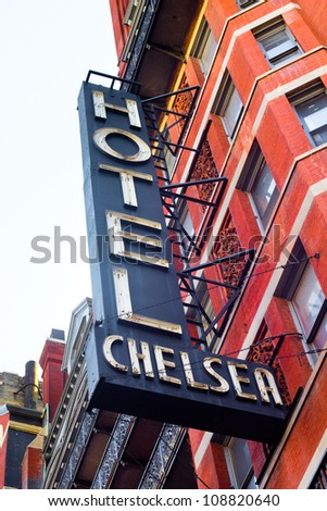 NEW YORK CITY - FEB. 3:  Historic NYC Chelsea Hotel signage seen on Feb. 3, 2012. This landmark hotel, known for its history of notable residents is located on 23rd Street was opened in 1884. - stock photo