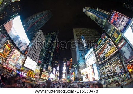 NEW YORK CITY - FEB 17: Times Square on February 17, 2012 in New York City. It is a busy tourist intersection of neon art and commerce and is an iconic street of New York City and America. - stock photo