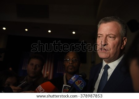 NEW YORK CITY - FEBRUARY 16 2016: Democratic presidential candidate Hillary Clinton appeared at Shomburg Center in Harlem to outline her vision for America's future. NYC mayor Bill de Blasio.