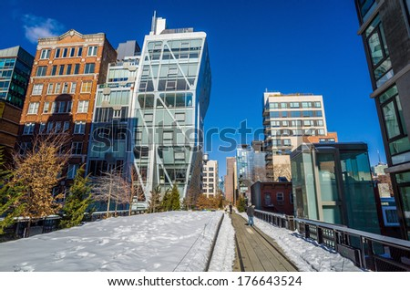 NEW YORK CITY - February 10: High Line Park in NYC on Feb. 10, 2014. In 2009 this former elevated freight railroad spur on NYC's west side opened as an aerial park garden and continues to expand. - stock photo