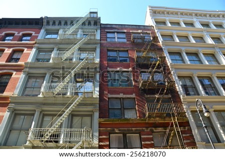 NEW YORK CITY - FEBRUARY 25, 2015: Old building with fire escape, New York City, USA. - stock photo