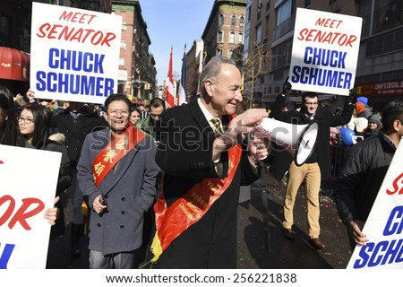 NEW YORK CITY - FEBRUARY 22 2015: the Chinese Lunar New Year was celebrated with a parade along Mott Street in Little Italy to mark the year of the sheep. US senator Charles Schumer with bullhorn
