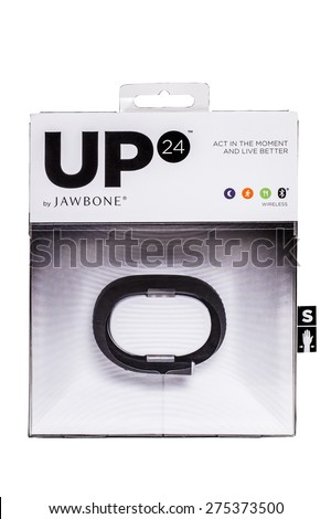 NEW YORK CITY - FEBRUARY 15, 2015:  UP24 Jawbone wireless fitness tracker wristband in package on against white background - stock photo