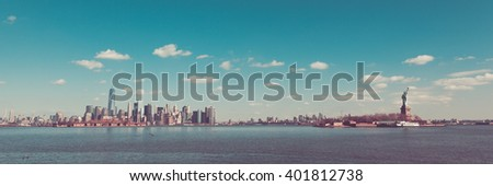New York City is seen from Liberty State Park in Jersey City, New Jersey. The Empire State Building, 432 Park, Freedom Tower, Ellis Island, Brooklyn, and the Statue of Liberty are all seen. - stock photo