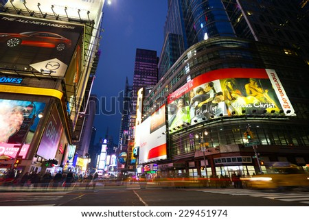 NEW YORK CITY - JAN13: Nighttime in intersection at 42nd Street, Broadway and Times Square  with pedestrian's crowds and traffic at hight on January 13, 2013 in New York, NY, USA. - stock photo
